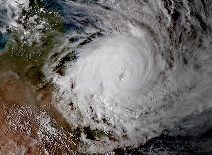 cyclone Cyclone definition, a large-scale, atmospheric wind-and-pressure system characterized by low pressure at its center and by circular wind motion, counterclockwise in the northern hemisphere, clockwise in the southern hemisphere see more.